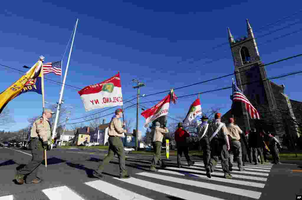 Boy Scouts of America carry flags as they walk toward Trinity Episcopal Church before funeral services for Benjamin Andrew Wheeler, Newton, Connecticut, December 20, 2012.