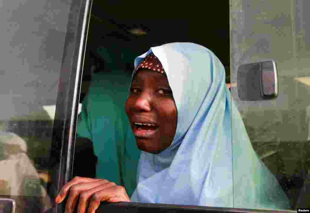 A rescued JSS Jangebe schoolgirl reacts after arriving in Jangebe, Zamfara, Nigeria, March 3, 2021. More than 270 schoolgirls kidnapped in northwestern Zamfara state were freed by their captors.