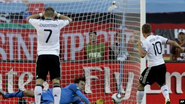 Serbia goalkeeper Vladimir Stojkovic, center, saves a peanlty kick by Germany's Lukas Podolski, right, during the World Cup group D soccer match between Germany and Serbia at Nelson Mandela Bay Stadium in Port Elizabeth, South Africa, 18 Jun 2010
