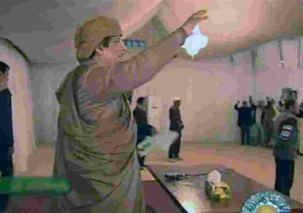This video image broadcast on Libyan state television Sunday Feb. 20, 2011 shows longtime Libyan leader Moammar Gadhafi appearing with numerous supporters at various events in Tripoli in the evening Saturday Feb. 19, 2011. Women and children were seen amo