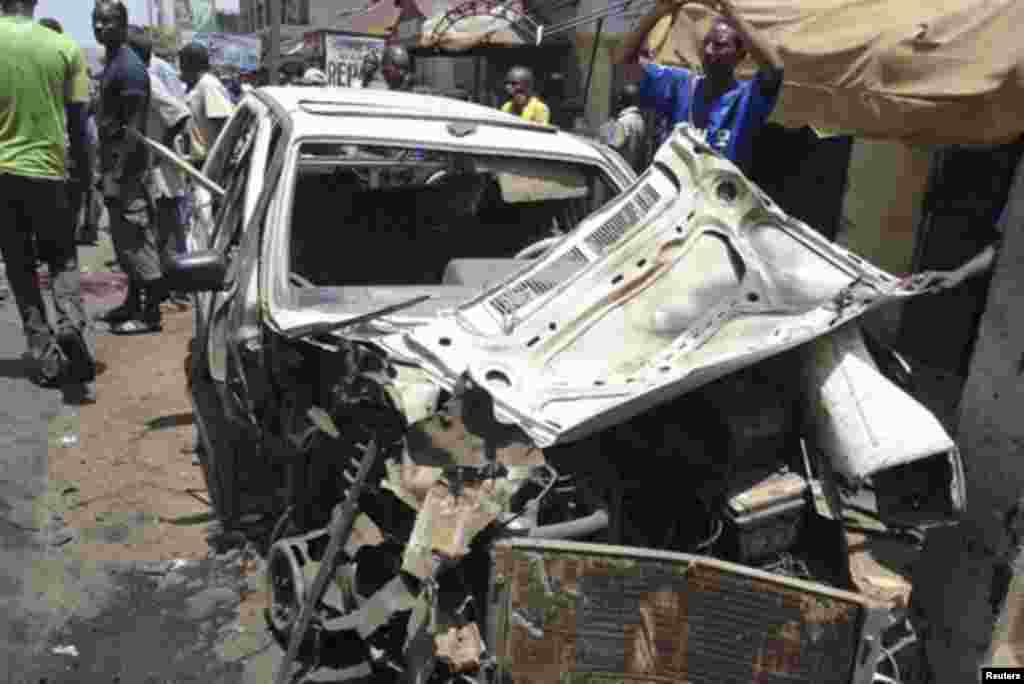 The wreckage of a car is pictured after a bomb blast in front of the office compound of Nigerian newspaper This Day in the northern city of Kaduna April 26, 2012.