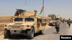 Tentara Angkatan Darat Afghanistan tiba di Distrik Nad Ali di provinsi Helmand, selatan Afghanistan, 10 Agustus 2016.