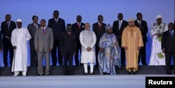 FILE - India's Prime Minister Narendra Modi (C) poses with his counterparts from African countries during the Inaugural Session of the India-Africa Forum Summit in New Delhi, India.