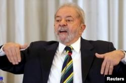 Former Brazilian President Luiz Inacio Lula da Silva reacts as he speaks during a news conference with international media in Sao Paulo, Brazil, March 28, 2016.