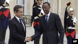 """France's President Nicolas Sarkozy, left, welcomes Rwandan's President Paul Kagame, right, at the Elysee Palace. Kagame has warned outside powers against trying to """"manage Africa"""" during a visit to France aimed at soothing tensions over the 1994 genocide"""
