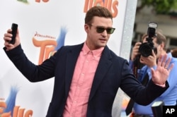 """FILE - Justin Timberlake arrives at the Los Angeles premiere of """"Trolls."""" Timberlake took a ballot box selfie that apparently violated Tennessee law. State officials say they have no plans to prosecute."""