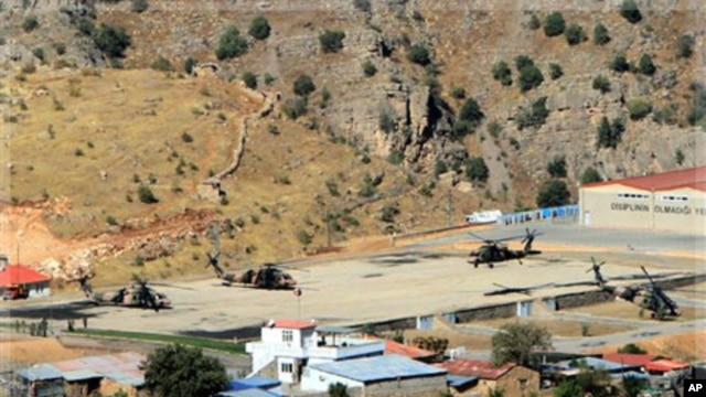 Turkish military helicopters are seen at a base in Cukurca, Hakkari, Turkey, at the border with Iraq, Thursday, Oct. 20, 2011.