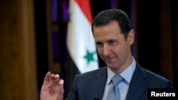 FILE - Syria's President Bashar al-Assad is seen during the filming of an interview with the BBC, in Damascus, Feb. 9, 2015.