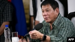 Then Philippines' president-elect Rodrigo Duterte speaks during a press conference in Davao on May 31, 2016.
