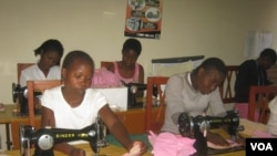 FILE - Girls in Malawi learn to make sanitary pads. A similar effort is under way in Uganda. (VOA / L. Masina)