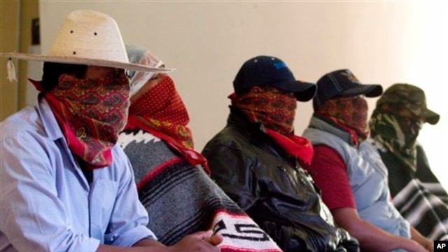 Masked members of the Purepecha Indian community guard unit, from the town of Los Reyes in Michoacan, Mexico, July 29, 2013.