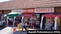 People eat at the tables outside Pa Ord Noodle 3, a Thai restaurant during the coronavirus disease (COVID-19) pandemic in Los Angeles, CA. Sept 2021.