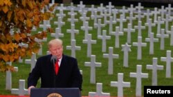 U.S. President Donald Trump speaks as he takes part in the commemoration ceremony for Armistice Day, 100 years after the end of World War One, at the Suresnes American Cemetery and Memorial in Paris, Nov. 11, 2018.