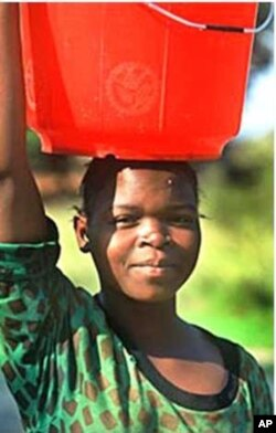 Women in urban areas carry water across long distances
