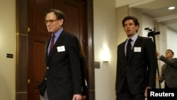 FILE - Sidney Blumenthal (L), a longtime Hillary Clinton friend who was an unofficial adviser while she was secretary of state, arrives to be deposed in private session of the House Select Committee on Benghazi at the U.S. Capitol in Washington, June 16, 2015.