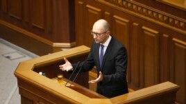 Ukrainian Prime Minister Arseniy Yatsenyuk addresses parliament in Kyiv July 24, 2014.