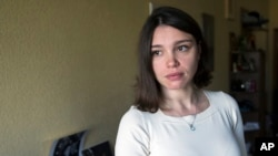FILE - Zhanna Nemtsova, daughter of slain Russian opposition politician Boris Nemtsov, speaks to the Associated Press in Moscow, Russia, May 13, 2015.