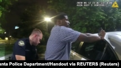 USA, Georgia, Atlanta, Former Atlanta Police Department officer Garrett Rolfe conducts a field sobriety test on 27-year-old Rayshard Brooks