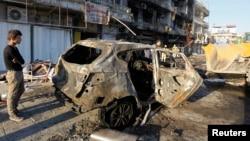 Hiện trường sau vụ nổ bom xe ở Baghdad ngày 9/11/2014.