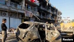 Kerusakan akibat bom mobil di Baghdad 9 November 2014.