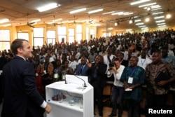 French President Emmanuel Macron speaks with students after he delivered a speech at the Ouagadougou University, in Ouagadougou, Burkina Faso, Nov. 28, 2017.