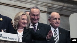 Secretary of State Hillary Clinton, (L) Sen. Charles Schumer (D-NY) and former New York Mayor Rudy Giuliani (R) participate in the opening bell ceremonies of the New York Stock Exchange, September 9, 2011. The New York Stock Exchange held ceremonies to ma