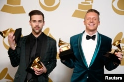 "FILE - Hip hop artists Macklemore (R) and Ryan Lewis pose backstage with their awards for Best New Artist, Best Rap Performance for ""Thrift Shop"", Best Rap Song for ""Thrift Shop"" and Best Rap Album for ""The Heist"", Jan. 26, 2014."