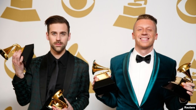 "Hip hop artists Macklemore (R) and Ryan Lewis pose backstage with their awards for Best New Artist, Best Rap Performance for ""Thrift Shop"", Best Rap Song for ""Thrift Shop"" and Best Rap Album for ""The Heist"", Jan. 26, 2014."
