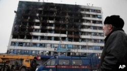 The burned-out 'Press House' is seen in central Grozny, Russia, Dec. 4, 2014.