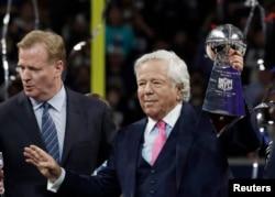 FILE - New England Patriots owner Robert Kraft celebrates with the Vince Lombardi Trophy after winning Super Bowl LIII, Feb. 3, 2019, in Atlanta, Ga.