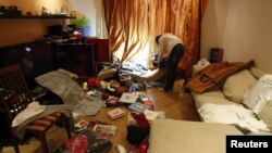 A journalist films the apartment of opposition leader and anti-corruption blogger Alexei Navalny after it was searched by police in Moscow