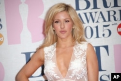 Ellie Goulding poses for photographers upon arrival at the Brit Awards 2015 at the 02 Arena in London, Feb. 25, 2015.