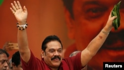 "Sri Lanka's former president Mahinda Rajapaksa waves at his supporters as he arrives at a protest rally to launch a plan to topple the current government, accusing it of failing in its ""management and development of the country"" in Colombo, Sri Lanka, Jan. 27, 2017."