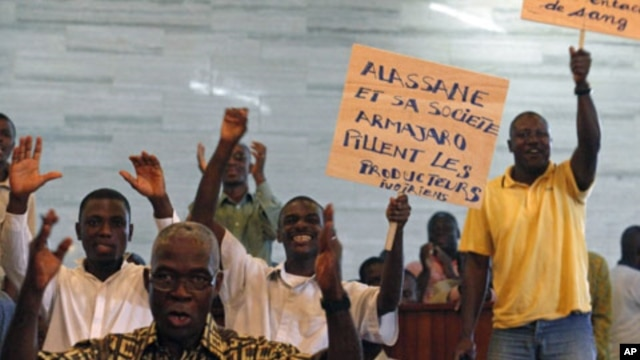People protest against the European Union in Abidjan, and Ivory Coast cocoa exporters said they feared for their future after presidential claimant Alassane Ouattara said he would extend one-month cocoa export ban if his rival refuses to leave power, Febr