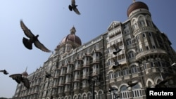 Pigeons fly outside the Taj Mahal Hotel, which was one of the targets of the attacks in Mumbai, Nov. 21, 2012.