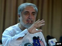 Afghan presidential candidate Abdullah Abdullah speaks at a press conference at his residence in Kabul, July 6, 2014.