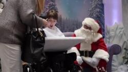 Santa Brings Christmas Joy To Deaf Children
