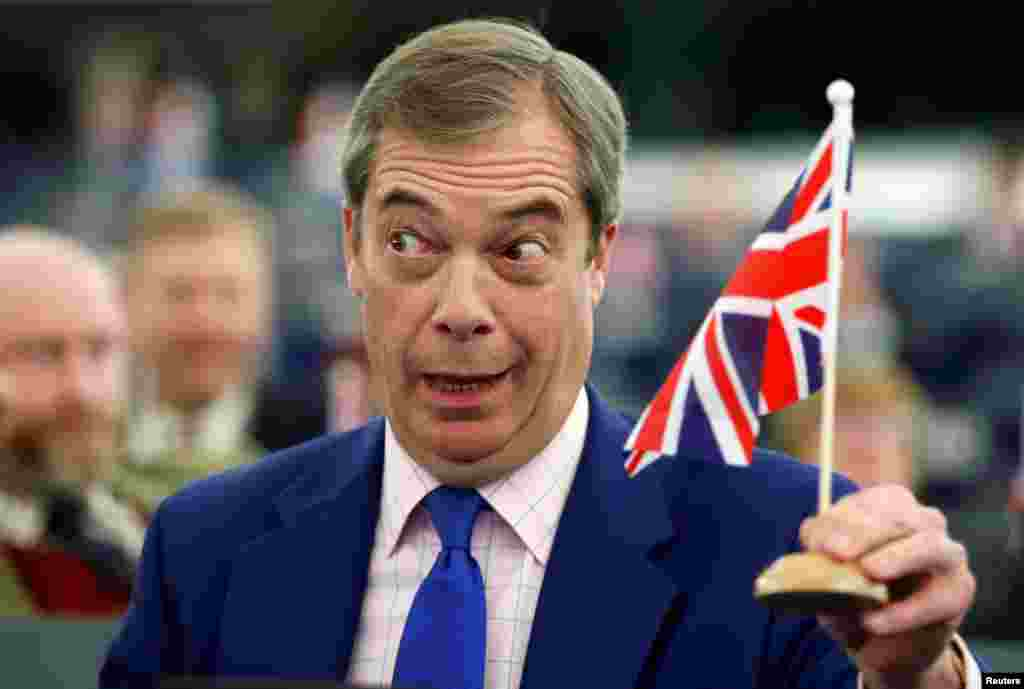 Brexit campaigner and Member of the European Parliament Nigel Farage holds a Union Jack flag during a debate on Brexit after the vote on British Prime Minister Theresa May's Brexit deal, at the European Parliament in Strasbourg, France.