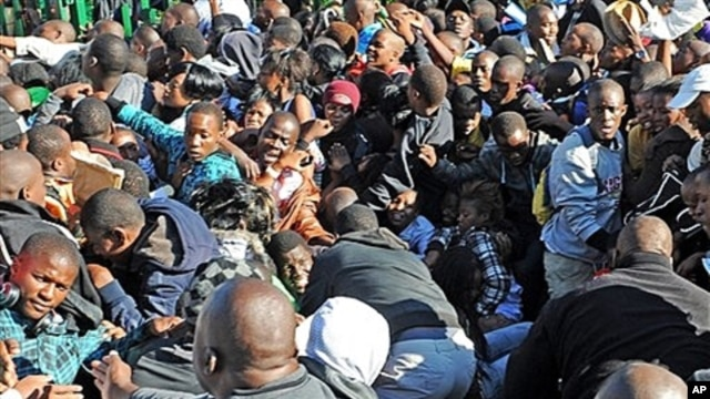 Thousands of young students and their parents push their way into the gates causing a stampede at the University of Johannesburg, South Africa on Jan. 10, 2012. One person died and two others were seriously injured, officials said.