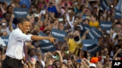 President Barack Obama greets the crowd after arriving for a campaign stop at Loudoun County High School in Leesburg, Virginia, Aug. 2, 2012.