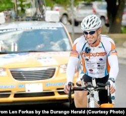 Len Forkas cycles during the 2012 Race Across America. He finished 10th in 2012 and won his age division. He started his charity HopeCam when his son Matt was diagnosed with cancer in 2002. His son is now a college graduate and does not have cancer.
