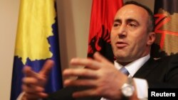 FILE - Ramush Haradinaj, a Kosovo Albanian former guerilla commander who served briefly as prime minister, speaks during an interview with Reuters at the AAK headquarters in Pristina, Dec. 4, 2012.