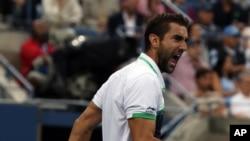 Marin Cilic dari Kroasia setelah mengalahkan petenis Jepang Kei Nishikori dalam final AS Terbuka (8/9). (AP/Mike Groll)