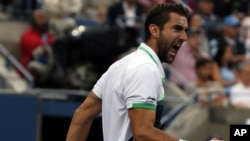 Marin Cilic, of Croatia, reacts to after a shot against Kei Nishikori, of Japan, during the championship of the 2014 U.S. Open tennis tournament, Monday, Sept. 8, 2014.