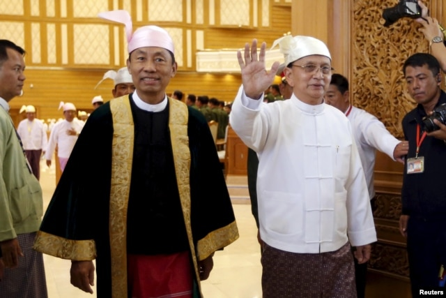 Myanmar's President Thein Sein, right, and parliament speaker Shwe Mann arrive at the Union Parliament in Naypyidaw, Jan. 28, 2016.
