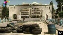 وێنهیهک له لایهن تهلهفزیۆنی فهرمی سوریا بڵاوکراوهتهوه که نیشانی دهدات هێزهکانی ئاسایشی سوریا له 14 مانگی شهشدا به ناو جسر ئهلشوغور بڵاوبوونهتهوه
