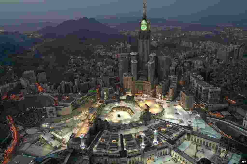 An aerial view of Saudi Arabia's holy city of Mecca, withthe Abraj al-Bait Mecca Royal Clock Tower overlooking the Grand Mosque and Kaaba in the center, is seen during the early hours of Eid al-Fitr, the Muslim holiday which starts at the conclusion of the holy fasting month of Ramadan.
