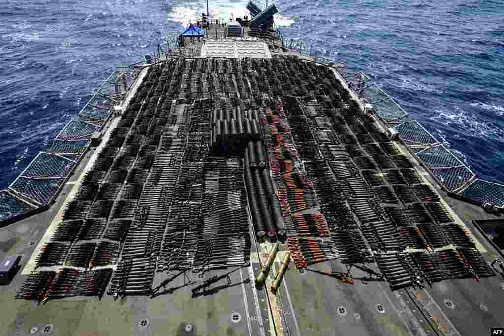This handout photo courtesy of U.S. Navy shows a vessel on which weapons were seized by the guided-missile cruiser USS Monterey in international waters of the North Arabian Sea.The U.S. Navy's Fifth Fleet said it had seized a huge cache of illicit Russian and Chinese weapons from a stateless dhow sailing in international waters of the North Arabian Sea.