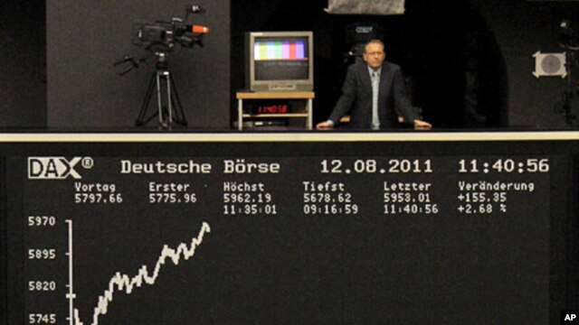 A man stands at the balcony above the DAX index board at Frankfurt's stock exchange, August 12, 2011