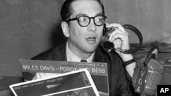Willis Conover, an expert on jazz, broadcasts from his Voice of America studio in Washington in March 1959. (AP Photo)